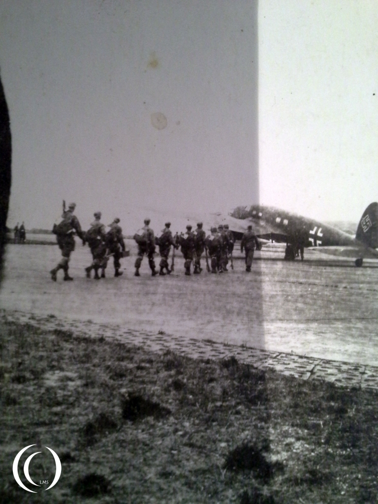 The Fallschrimjäger walking to their transport plane, a Heinkel HE 111 in Italy