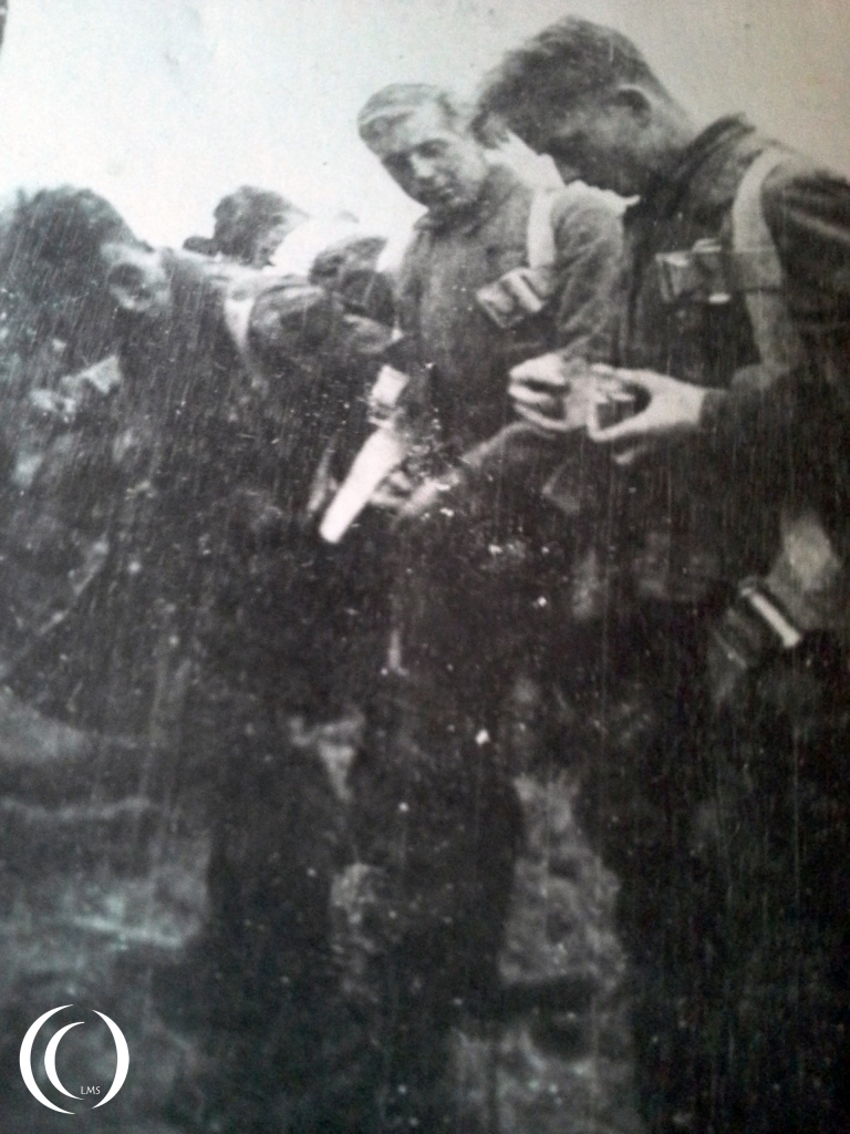 Fallschirmjägers getting ready for a jump, probably Sicily Italy