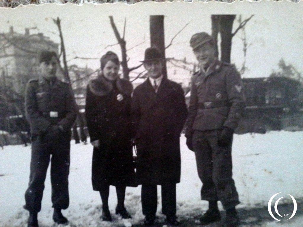 Mr Hornig with his parents and a friend