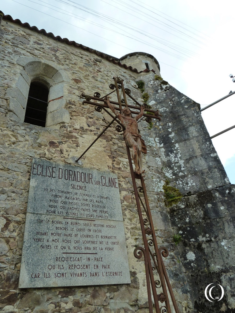 The plaque on the wall left of the church entrance