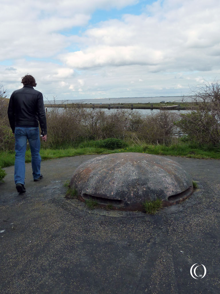 Patrick walking past the observer cupola of casemate II Kornwerderzand