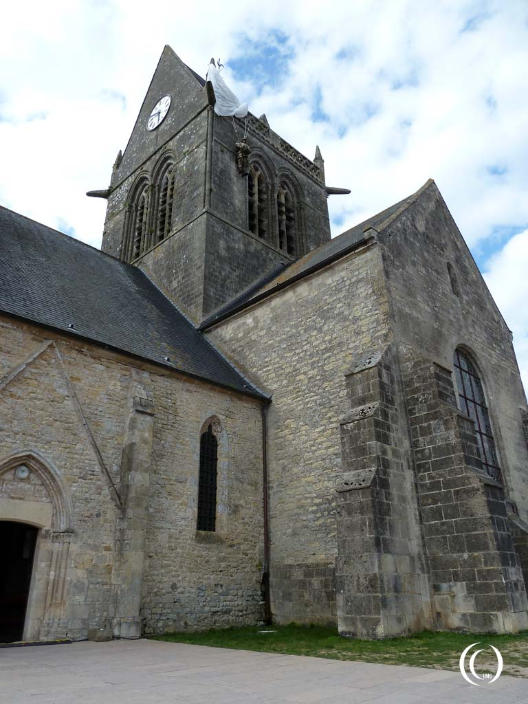 The church at Sainte-Mère-Église with paratrooper John Steele hanging from the tower - Normandy, France
