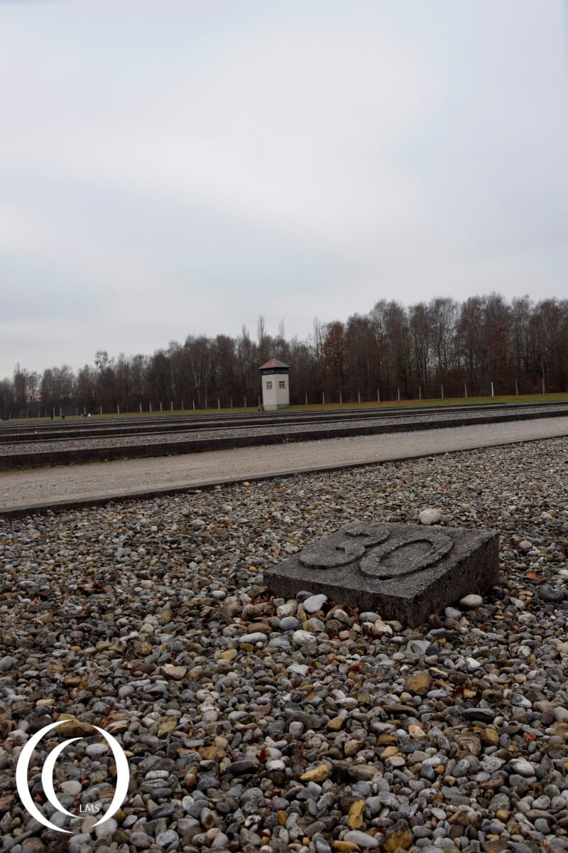 Dachau had 32 barracks, the outlines can been seen with a guard tower in the back