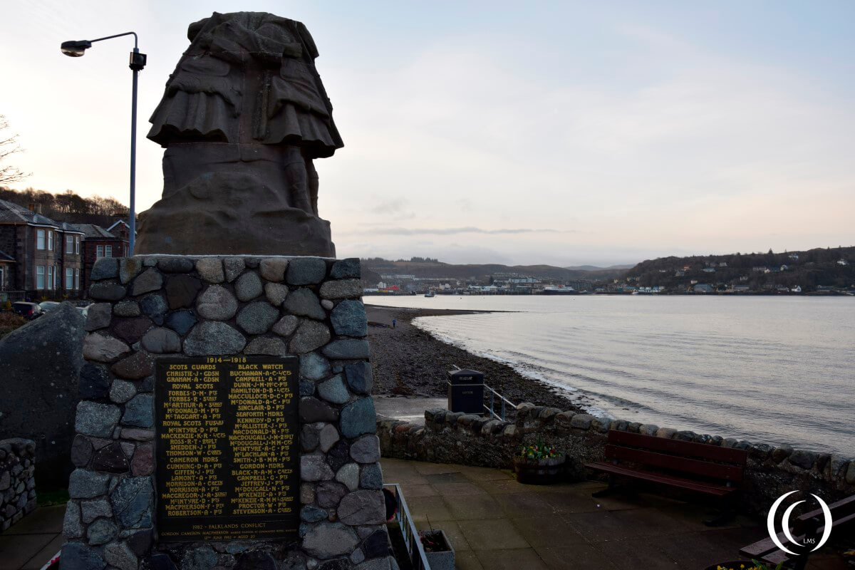 Oban war memorial Scotland, with the city of Oban in the back