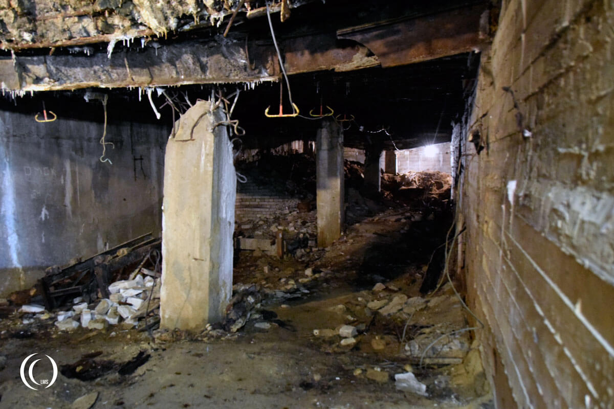 A view down the communications room with blast damage at Zeppelin bunker Zossen