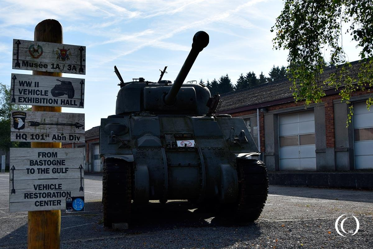 Signpost and sherman tank at the entrance