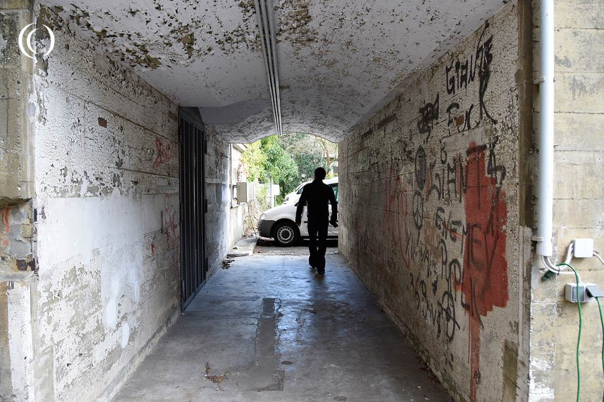 Patrick walking to the bomb protective corridor in from of the entrance of the Hochbunker