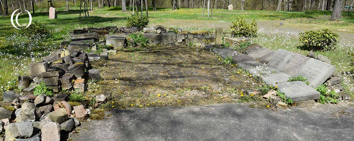 Stone remnants of headstones and memorials at the cemetery